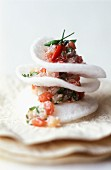 Sea bream and coconut tartare with prawn crackers