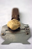 A white truffle and a truffle slicer
