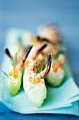 Celery sticks with trout caviar and shrimps