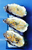 Hot oysters with orange butter