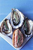 Fresh oysters and duck crostino with pepper