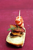 Scallop skewers with crispy bacon and crab tails