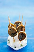 Limpet skewers with thyme flowers