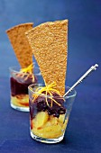 Verrine of citrus fruit with blackberry sorbet and crunchy biscuit
