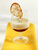 Verrine of white garlic cream with virgin malaga aspic