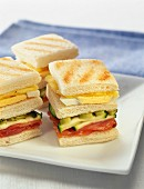 Small toasted sandwiches with salmon,cucumber and hard boiled egg