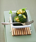 Round courgettes stuffed with curried white tuna