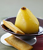 Pear poached in Indian tea and green tea financiers