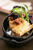 Sauteed rabbit with prunes and diced bacon