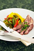 Pan-fried pork with peppers and saffron pistils