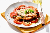 Breaded turkey escalopes with tomatoes and basil