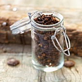 Small glass jar of cloves