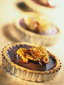 Chocolate tarts with dried fruit, nuts and caramel