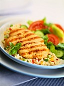 Grilled chicken escalope on pepper rice with salad