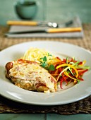 Gratinated veal escalope with ham and cheese