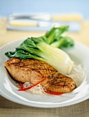 Grilled salmon steak with bok choy