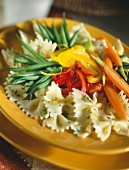 Farfalle with vegetables and orange zest