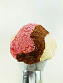 A scoop of Neapolitan ice cream