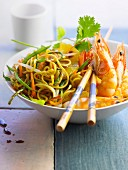 Vegetables and noodles sauteed in a wok,shrimps and pineapple