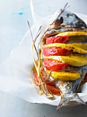 Baked sea bream with mango and tomato