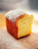 A Buchtel ((baked, sweet yeast dumpling) dusted with icing sugar