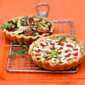 Goat's cheese and tarragon quiche,vegetable and tapenade tartlet