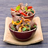 Beef wok with bell pepper and basil and beef wok sautéed with lemongrass