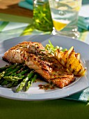 Grilled salmon fillet with green asparagus