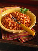 Elbow macaroni with tomato sauce and onions