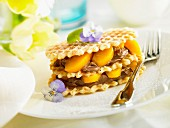 Waffles layered with chocolate mousse and peaches