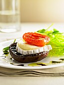 A mushroom, goat's cheese and tomato canapé