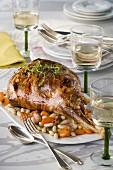 Leg of lamb à la bretonne with white beans and carrots