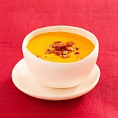 Pumpkin soup with ham and sesame seeds