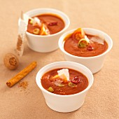 Tomato soup with spices and Parmesan shavings