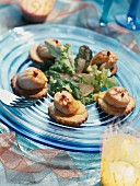 Marinated scallops on sesame seed butter biscuits with fish roe sabayon