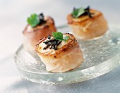 Scallops wrapped in bacon with truffles