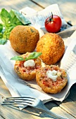 Breaded risotto balls with tomato,basil and mozzarella