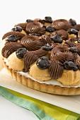 A profiterole cake with ganache