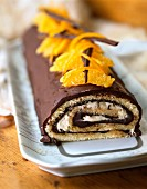 Bûche (French log cake) with chocolate and celmentines