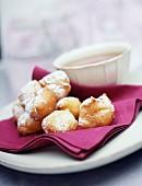 Round sugar doughnuts and a bowl of hot chocolate