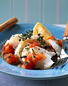 Shredded cod with tomatoes