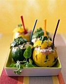 Yellow and green round stuffed courgettes