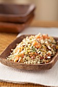Quinoa tabbouleh with salmon and hazelnuts