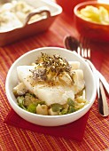 Half-cooked cod with medium-dry goat's cheese and potato and citrus fruit salad