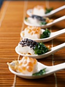 Bite-size rice cakes with salmon roe and caviar