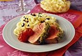 Roast beef covered with grilled pesto and taglatelles with tapenade