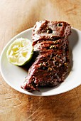 Flank with lemon and green pepper sauce