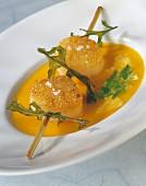 Pumpkin soup with scallop brochette