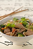 Chicken and vegetables cooked in a wok