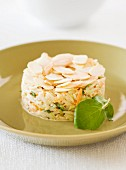 Rice timbale with carrots and flaked almonds
